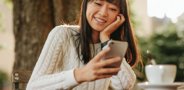 woman smiling looking at phone